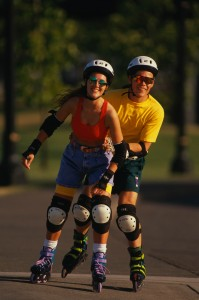 physical activity - young couple rollerblading