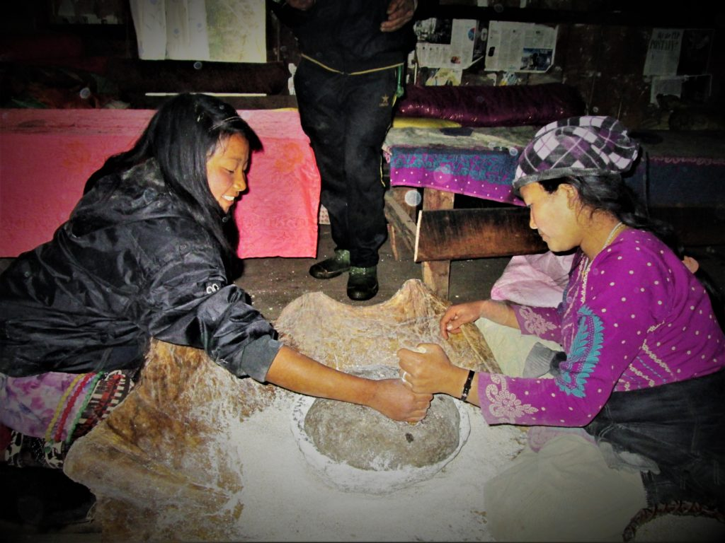 whole grains being ground by hand